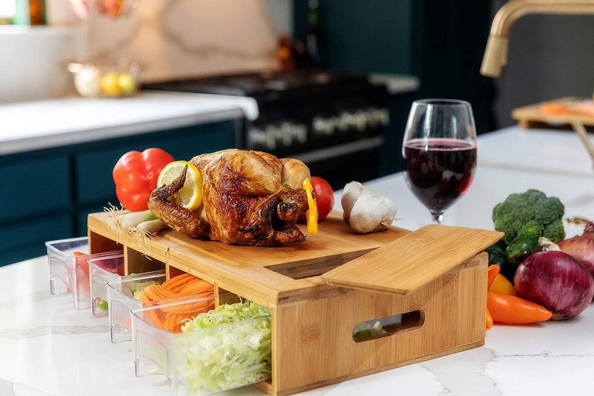 Cutting board with container